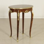 Oval coffee table with bronze and inlaid-detail