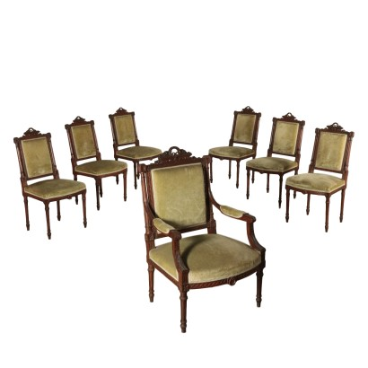 Set of six Carved Chairs and Armchair Italy 20th Century
