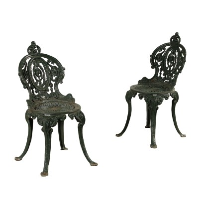 The pair of chairs in cast iron