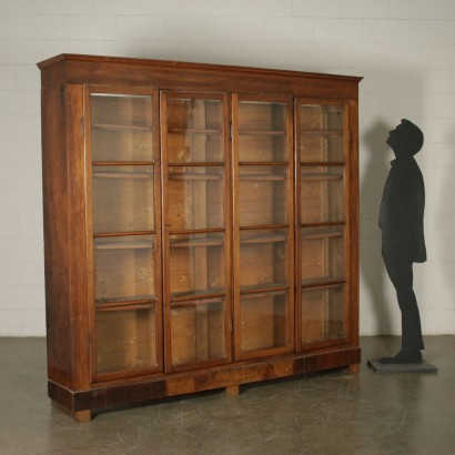 Walnut bookcase manufactured in Italy in early 19th Century