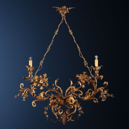 Iron chandelier gilded